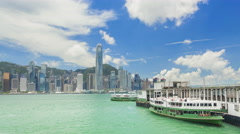 4k timelapse video of ferry terminal and Victoria Harbour in Hong Kong Stock Footage