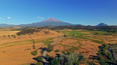 Farmlands and pastures with Shasta mountain in the background - stock footage