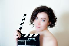 Young beautiful actress with clapper board Stock Photos