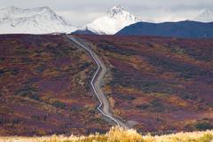 Oil Transport Alaska Pipeline Cuts Across Rugged Mountain Landscape Stock Photos
