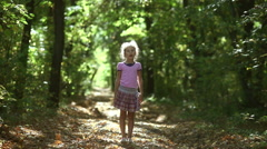 Teen girl in the forest raises his arms to the sun meditation oneness with Stock Footage