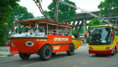 Stock Video Footage of Amphibious, duck walker vehicles carrying tourist passengers. Singapore