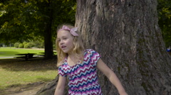 Little Girl Looks Around Park, After Counting For Hide And Seek - stock footage