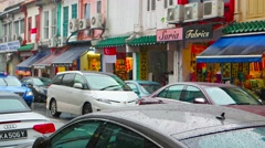Traffic on an urban street in Singapore on a rainy day. Arab quarter Stock Footage