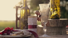 Table for a romantic dinner in the park at sunset Stock Footage