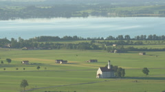 Amazing rural landscape of a church and houses near Forggensee, Fussen Stock Footage