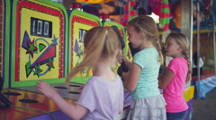 Stock Video Footage of Three little girls start to play a carnival game together