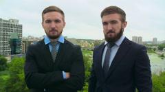 Successful Twin Businessmen Stock Footage
