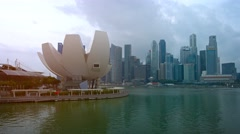 Lotus shaped architecture of the ArtScience Museum and Singapore's skyline Stock Footage