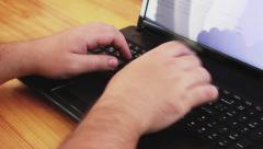 Hands typing text on notebook - stock footage