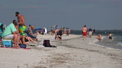 Beachgoers mingle on a beach in Florida. Stock Footage