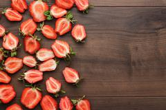 strawberries on the wooden table - stock photo