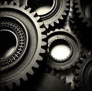 Metal cog wheels bonding together Kuvituskuvat