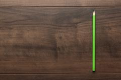 green pencil on the table - stock photo