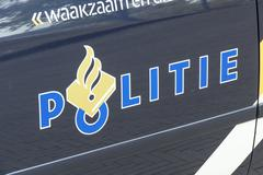 Police car with police logo in The Hague. Kuvituskuvat