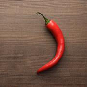 Red hot chilli pepper on wooden table Stock Photos