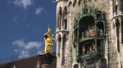 Munich New Town Hall time-lapse clouds at Marienplatz with Mariensaule statue Stock Footage