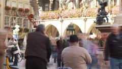 Time-lapse Munich New Town Hall Marienplatz buskers and crowd Stock Footage