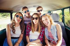 Beautiful young people a on road trip - stock photo