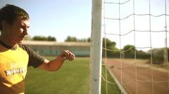 Man football upset defeat shouts knocks on the goal post sport stadium goal Stock Footage
