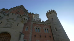 Gateway - the eastward-pointing gate of Neuschwanstein Castle in a sunny day Stock Footage