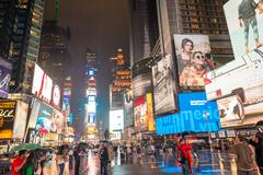 Stock Photo of NEW YORK CITY - JUNE 13, 2013: Blurred view of a rainy night scene in Time Sq