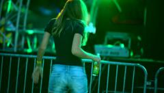 Young woman dancing at a electronic party on the beach Stock Footage