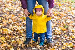 Young family for a walk in the autumn park with baby - stock photo