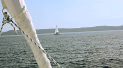 Boat catamaran sails on the sea RG Stock Footage