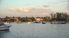 Motorboats pass in a Florida bay at dusk. Stock Footage