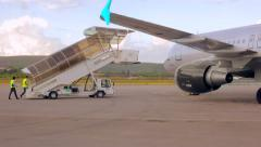 Mobile staircase trucks on the airport come to the plane RG Stock Footage