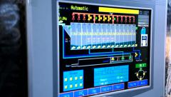 Worker adjusts the operation of the industrial machine on the touch screen Stock Footage