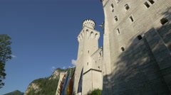 Flags waving next to Neuschwanstein Castle entrance Stock Footage