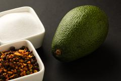 avocado with seasoning - stock photo