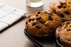 chocolate chip muffins in pan - stock photo