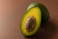Cut avocado Stock Photos
