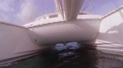 Bottom of the boat Catamaran while sailing on the sea RG Stock Footage