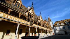 Iconic courtyard of Hotel Dieu in the Beaune, Burgundy, France, Europe Stock Footage