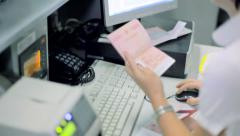 Checking the passports and selling a tickets at the airport RG Stock Footage