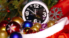 Clock and christmas toys in a red bag, timelapse - stock footage