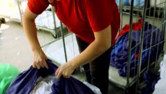 Woman unpacking dirty laundry for washing RN - stock footage
