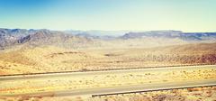 Retro toned panoramic country highway, USA. Stock Photos