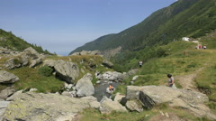 Relaxing near the small river from Transfagarasan Stock Footage