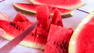 Stock Video Footage of Sliced ripe red watermelon with a knife