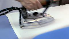 Woman ironing a clean white clothes Stock Footage