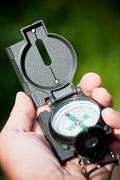 Compass, navigation instrument - stock photo