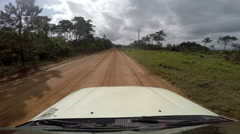 Safari truck driving along a dirt road Stock Footage