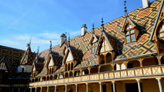 Typical coloured roof of the Hotel Dieu in the Beaune, Burgundy, France. Stock Footage