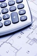 Calculating expenses for building new home - stock photo