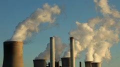 Chimneys at coal fired powerstation - air pollution - stock footage